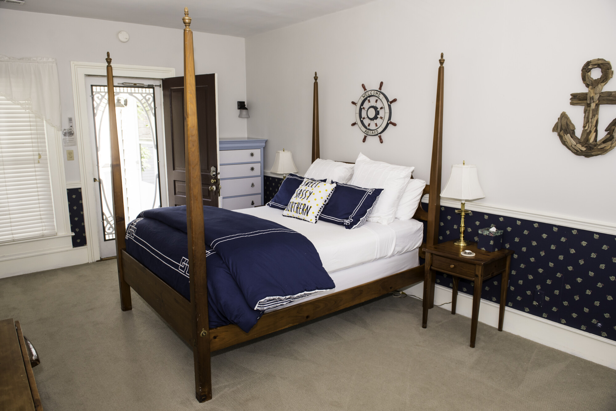 Queen size bed with blue color tone