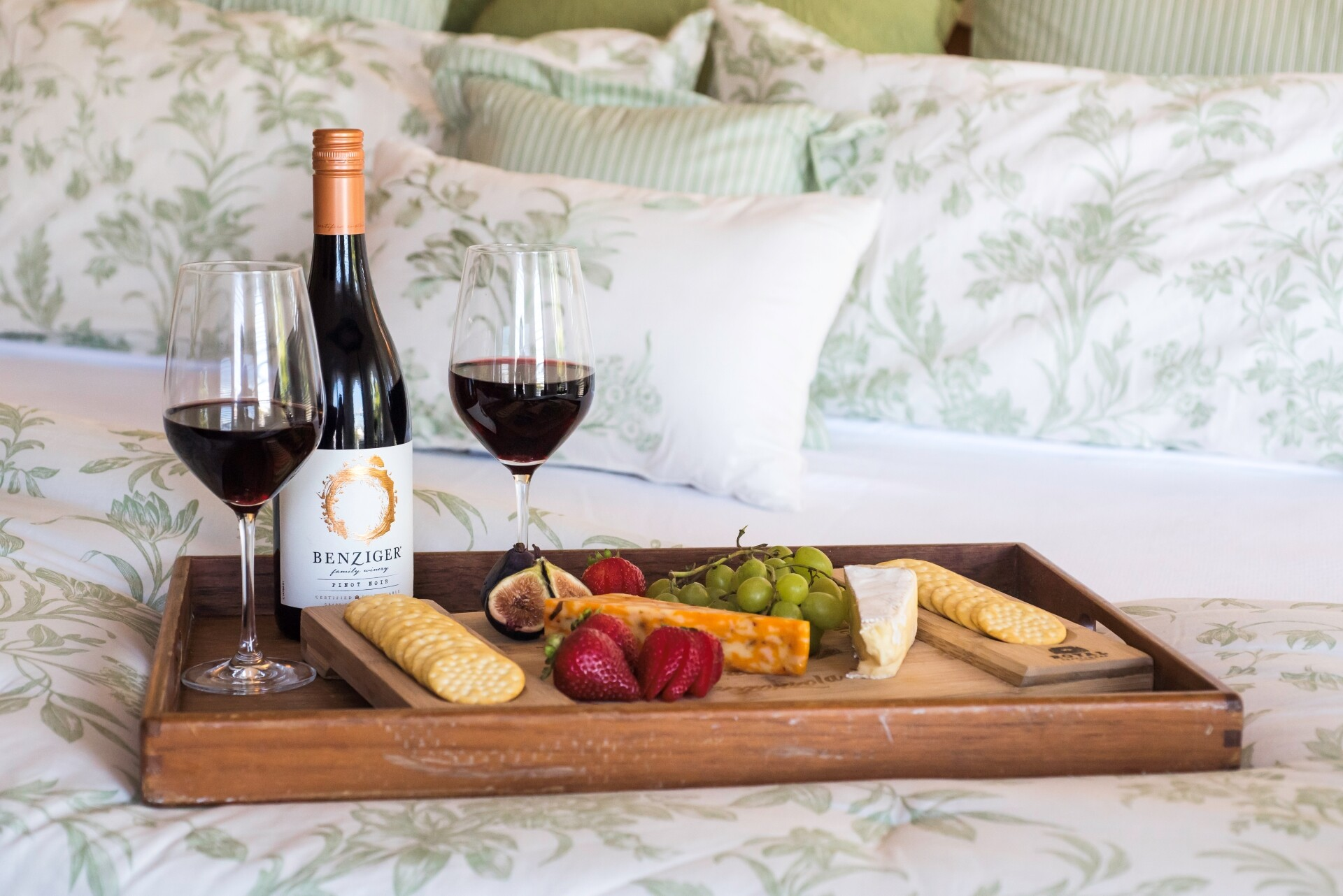 King bed with wine and cheese tray