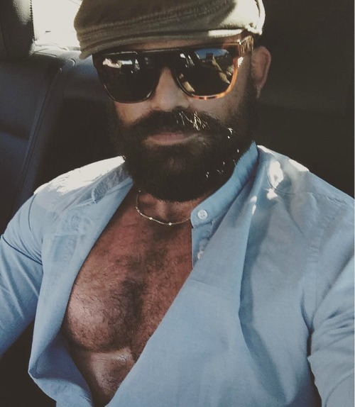 Kai Berlin in open shirt and shades.