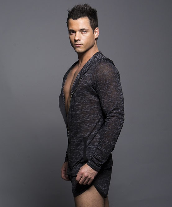Model sporting Andrew Christian Touch Skinny hoodie from the side.