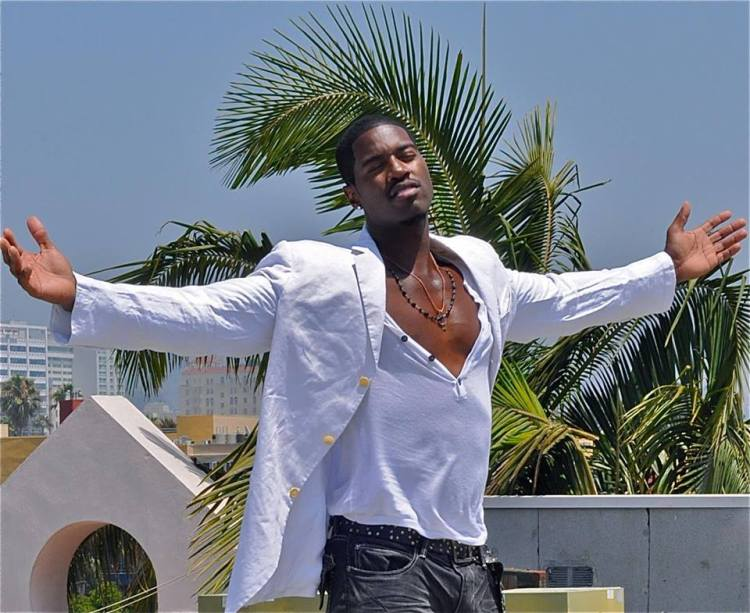 Singer actor Terrell Carter looking sexy with his arms open wearing white blazer and unbuttoned white Henley