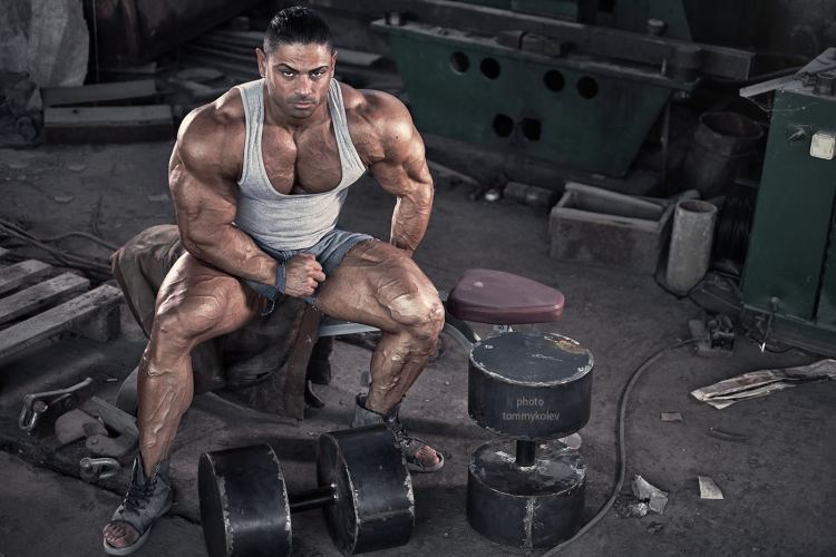 "Dobromir ""Dobri"" Delev sitting proud pecs in tank top"