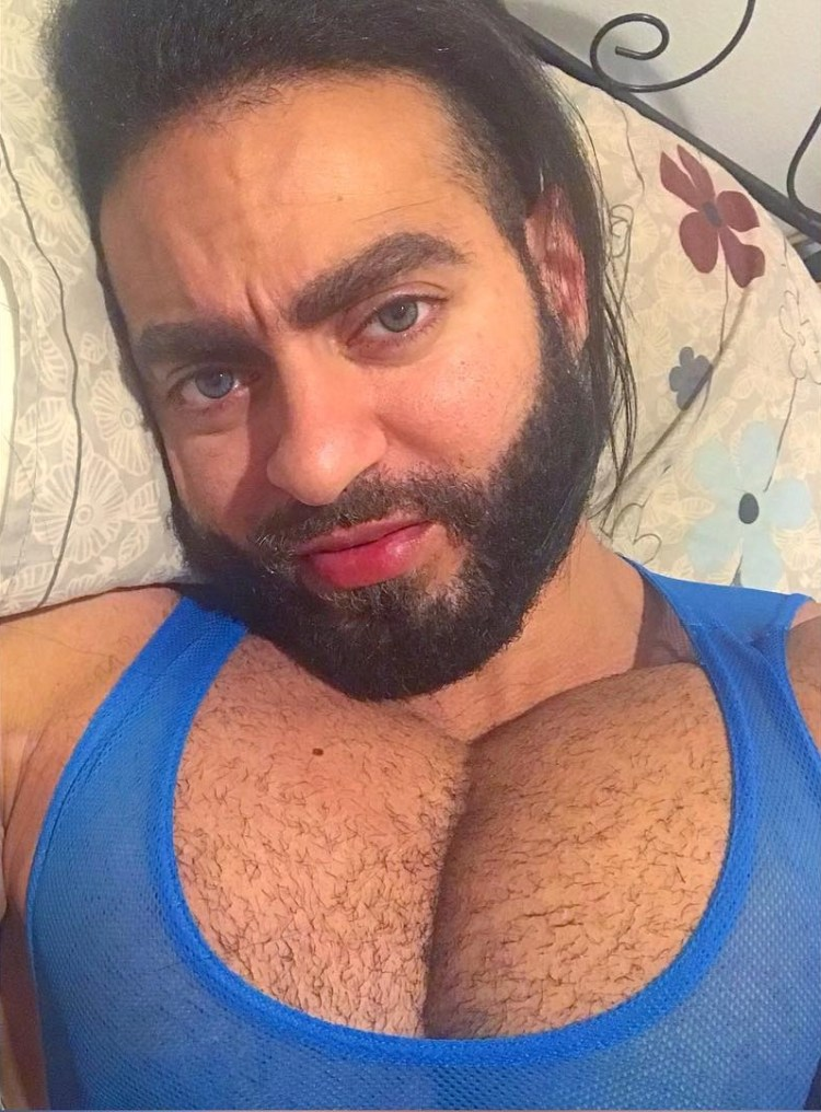 Sherif Yakout gigantic cleavage in tank top laying in bed