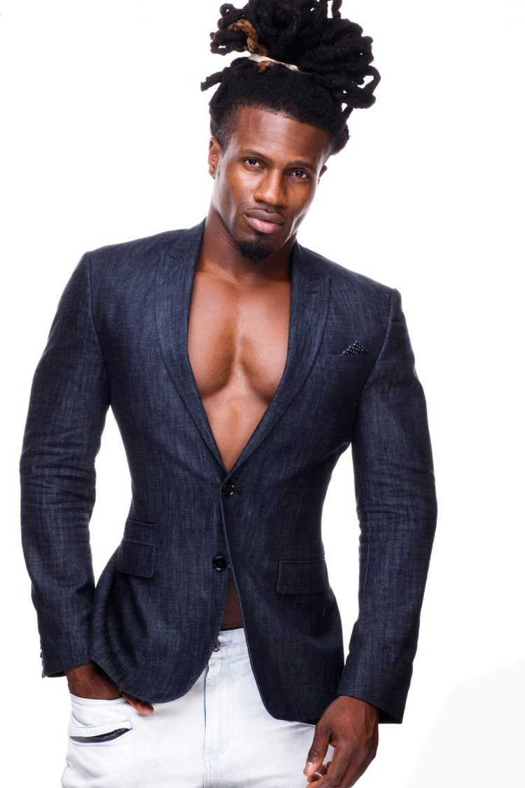 Wentworth Michel posing with hands in his pockets, wearing tight blazer and nothing underneath. Cleavage galore
