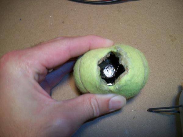magnet glued inside tennis ball