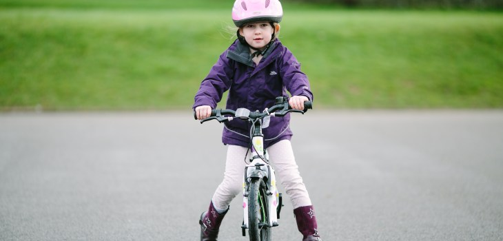 Reception Children from St Marks School l;earning to ride their bikes.