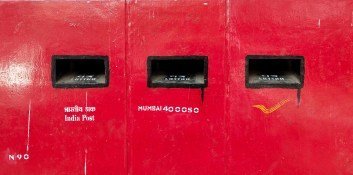Three letter boxes outside a Postal office