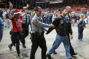 Protester being escorted away at Trump rally.