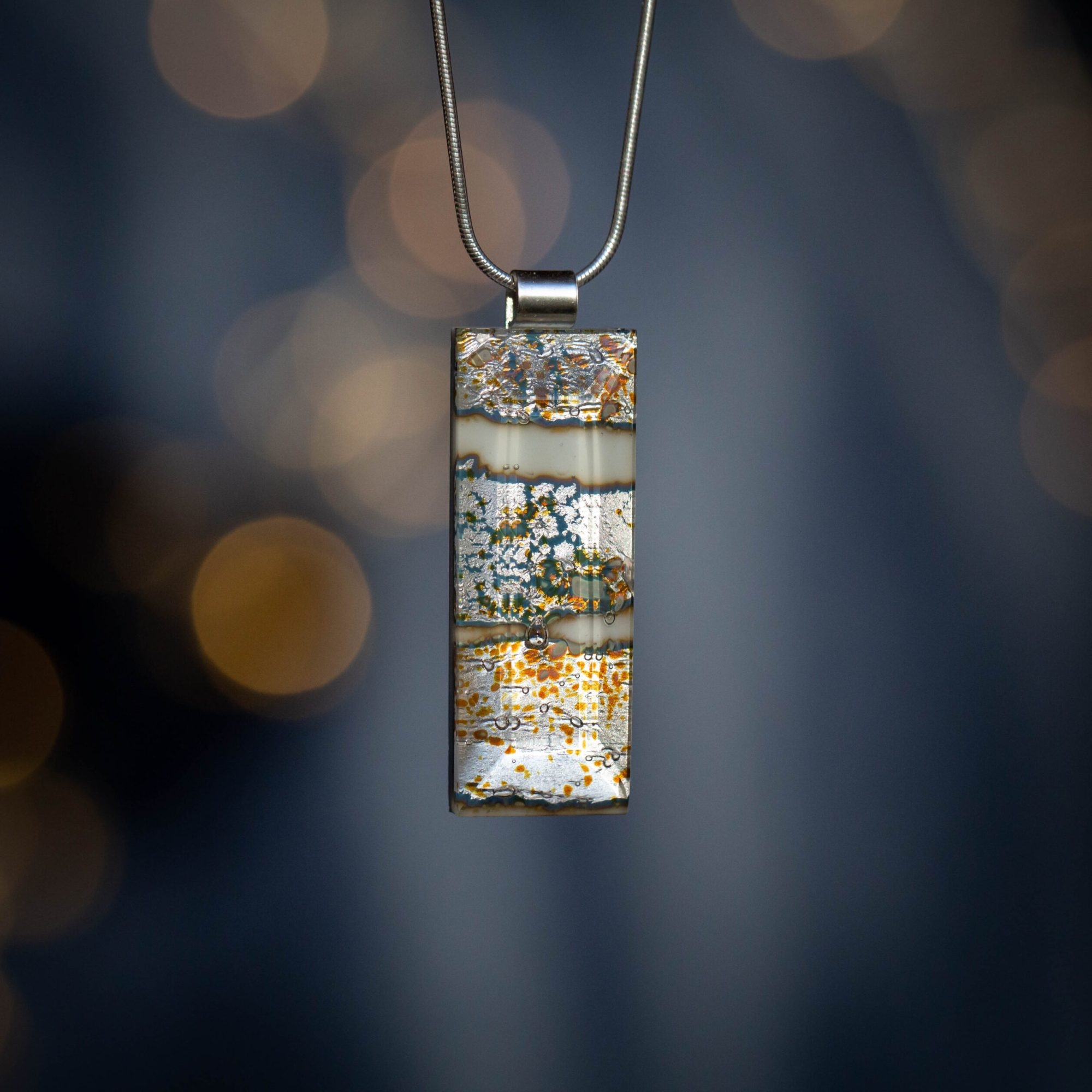 Lucie Harris Glass, stylish silver gold and blue pendant with silver chain