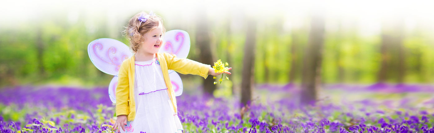 little girl in flower field
