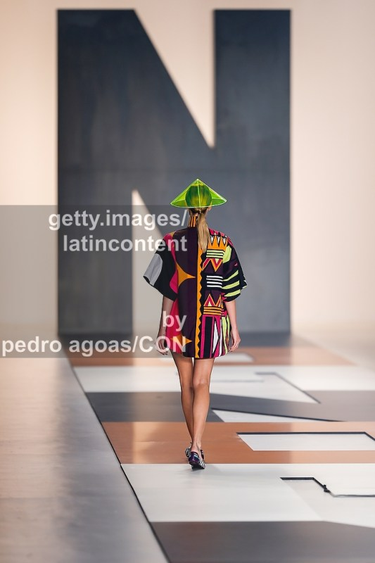 SAO PAULO, BRAZIL - MARCH 20: A model walks down the runway showing a design by Neon during São Paulo Fashion Week (SPFW) Summer 2013/2014 on March 20, 2013 in São Paulo, Brazil. (Photo by Pedro Agoas/LatinContent/Getty Images)