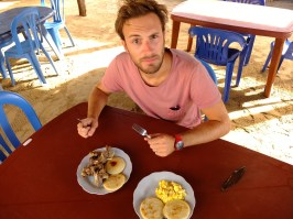 Trying the local breakfast : goat meat