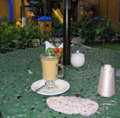 6.10 coffee in garden of hotel with knitting