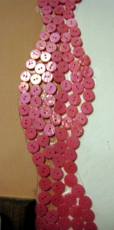 01.7 buttons make art on wall