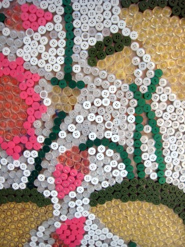 03.4 buttons detail of lily pad art on wall