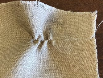 Image result for pulling a thread in a weave