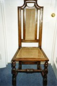 The finished chair, aged and caned.