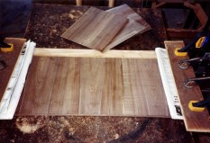 Veneering the lower face of the top leaf.