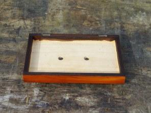 Pommel nuts recessed into lid.