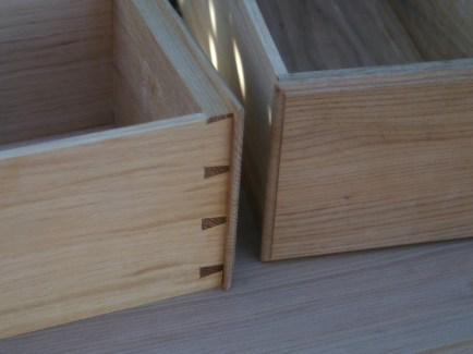 Lipped and moulded drawers.