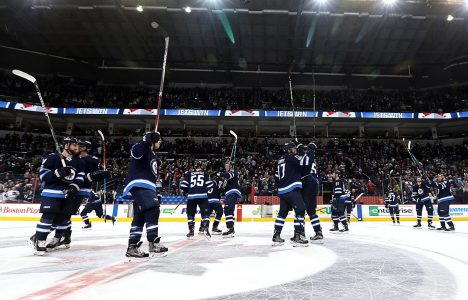 Winnipeg Jets on ice near the center