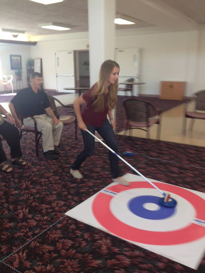 Floor curling-helping seniors keep active-PEI native Erin Carmody & skip Laura Crocker give it a try