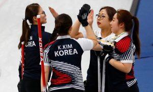 South Korean curling team ward off more seasoned rivals (The Guardian)