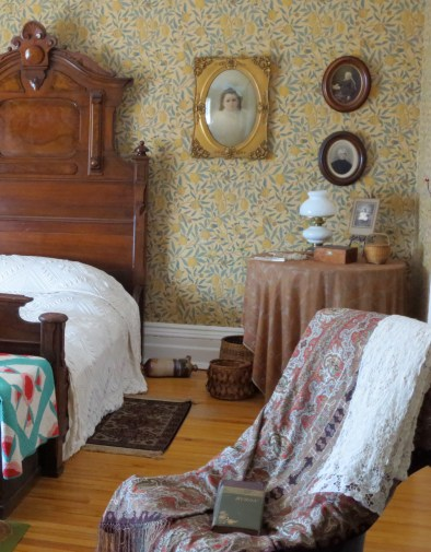 2nd-floor bedroom furnished with period pieces. Photo credit: M.W. Ferris Photography