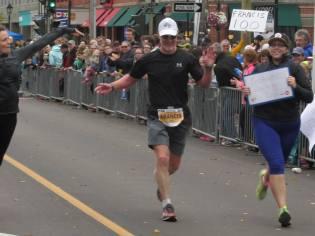 Francis Fagan crossing finish line 100th - FB at J. Norman-Bain