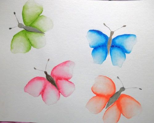 papillons colorés à l'aquarelle
