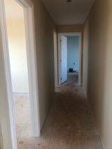 The hallway leading to all bedrooms.