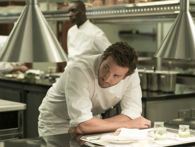 BRADLEY COOPER (front) and OMAR SY (back) star in BURNT.