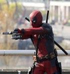 """51703770 Actor Ryan Reynolds suits up to film and action scene on a viaduct for """"Deadpool"""" on April 7, 2015 in Vancouver, Canada. The new Marvel movie tells the story of a former Special Forces operative turned mercenary who is subjected to a rogue experiment that leaves him with accelerated healing powers. FameFlynet, Inc - Beverly Hills, CA, USA - +1 (818) 307-4813"""