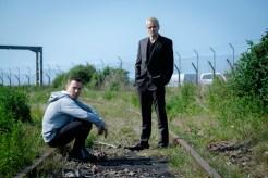 Ewan McGregor as Mark Renton and Jonny Lee Miller as Simon on railway tracks in TriStar PicturesÕ T2: TRAINSPOTTING