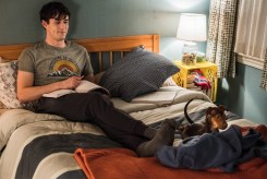 Lucas (Jonah Hauer King) and baby Bella have a moment in Columbia Pictures' A DOG'S WAY HOME.