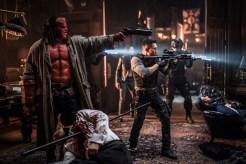 David Harbour as 'Hellboy', Sasha Lane as 'Alice Monoghan', and Daniel Day Kim as 'Ben Daimio' in HELLBOY. Photo Credit: Mark Rogers.