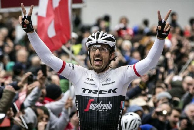 Fabian Cancellara of Trek-Segafredo Team celebrates victory as he crosses the finish line during the 2016 Strade Bianche from Siena's Fortezza Medicea to Siena's Piazza del Campo, Italy, 5 March 2016. Strade Bianche is a 176km road race containing seven sectors of white gravel roads. ANSA/ANGELO CARCONI