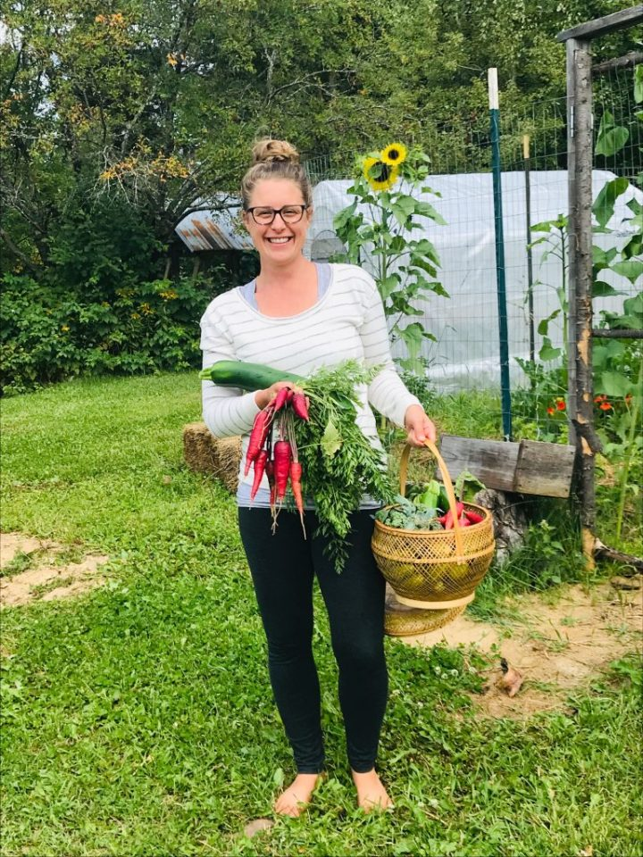 Lindsey Dietz with a basket full of homegrown garden produce
