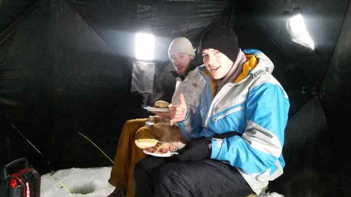 Enjoying lunch in an Ice Hut on Lost lake