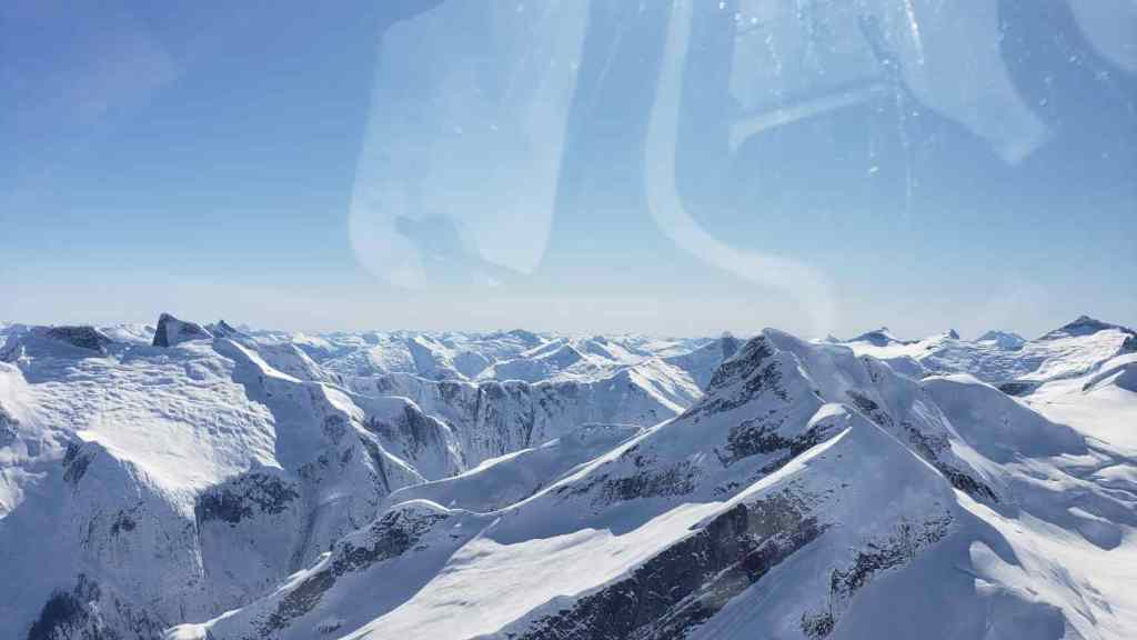 Helicopter flight over coastal mountains of British Columbia