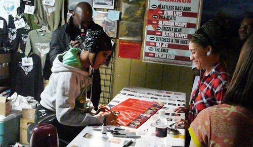 Erykah Badu signs her album for a fan. (Photo by Anna Paige)