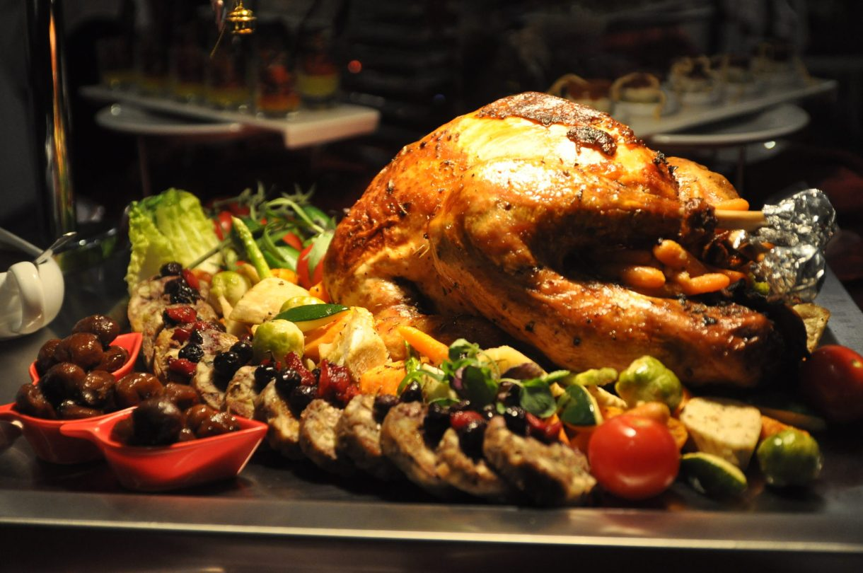 roasted-turkey-with-giblet-gravy-cranberry-sauce-glazed-nuts-sage-bread-stuffing-sweet-potato-seasonal-vegetables-christmas