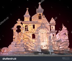 stock-photo-beautiful-winter-ice-sculpture-of-a-frozen-castle-at-the-ice-sculpture-carving-festival-214707829