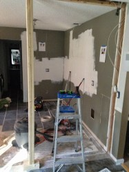 Demolishing the wall between kitchen and dining room