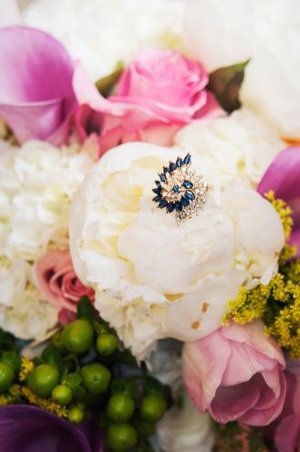Antique ring nests in bouquet of flowers as something blue and something borrowed for Southern wedding tradition