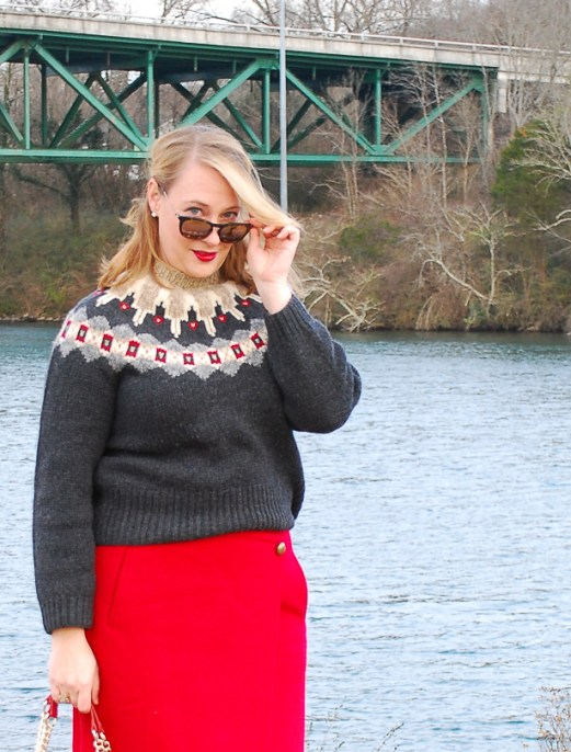 Wrap yourself in a stylish wool on wool outfit to beat the bitter winter weather. #winteroutfit #redskirt #fairislesweater #modernclassicstyle