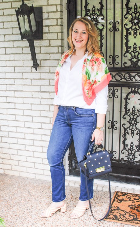 Young blond in preppy wardrobe staples: white oxford, dark wash denims, heels, and scarf.