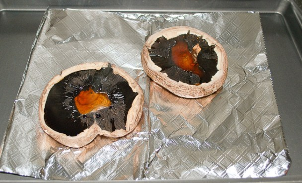 Bake the portobello mushrooms first before filling with sausage stuffing.