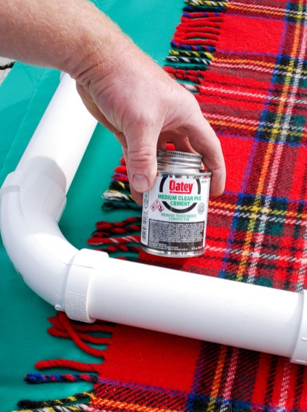 Step to glue PVC pipes together for this DIY outdoor Christmas decoration - PVC joy sign.