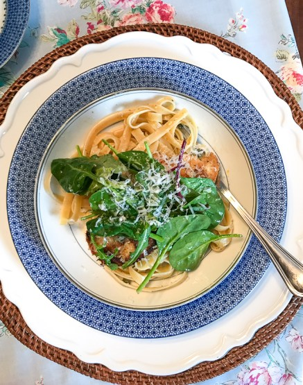 Chicken piccata on blue lace plate